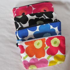 A set of 4 Marimekko pouches, sunglass, cosmetic bag, wallet, Mini Unikko fabric from Finland in 6 colors, stocking stuffer, bridesmaid gift by mummiquilts on Etsy https://www.etsy.com/listing/170245120/a-set-of-4-marimekko-pouches-sunglass