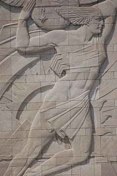 Art Deco Winged Male Bas Relief, Union Terminal Museum, Cincinnati, Ohio. Then again, I'm not so sure it's a male--I seem to see a breast under the coy wind-blown scarf. Then again, if it's a female, she's got some well-developed leg muscles. Then again, it IS the 1930s, when musculature was heroic. On the other hand, I see pyramids and a sun, so maybe it's Helios, the sun god. Put it this way: it's hard to tell. Magnaverde.