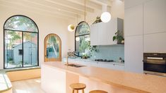 Kitchen Themes, Kitchen Colors, Kitchen Designs, Green Kitchen Island, Yellow Cabinets, Stucco Homes, Blue Backsplash, Small Toilet, Old Cottage