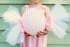 Make your own giant candy decorations or favors with round paper lanterns wrapped in poly deco mesh.