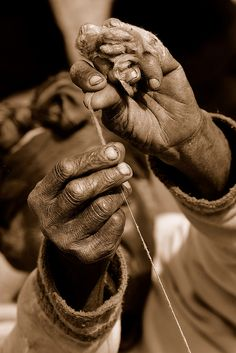 hard worked hands and silk, via Flickr.