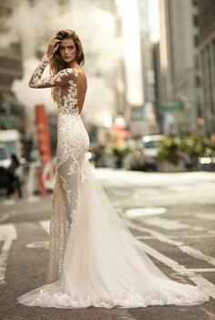 Illusion lace sleeved wedding gown with plunging back // BERTA's Fall/Winter 2017 bridal collection is sending us to #weddinggown heaven with its showstopping silhouettes matched beautifully with 3D flowers, lace appliques and rich embellishments.