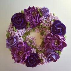 Buttercream floral wreath in shades of purple + touches of gold #buttercream #floral #wreath #purple #lavender #lilac #gold