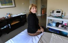 Ann Robinson sits in a newly renovated birthing room at Kitchener-Waterloo Midwifery Associates in Kitchener this week.