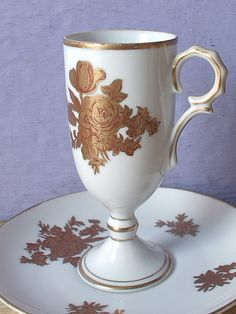 Vintage Gold Roses Teacup and Saucer, White Porcelain tea cup, Japanese tea cup, Red roses tea cup, Demitasse tea cup, Pedestal tea cup  Both pieces are unmarked. They no longer have the stickers from the Japanese maker.  No chips. No cracks.  I have more teacups available:  https://www.etsy.com/shop/ShoponSherman  I have more vintage & antique items in my shop:  https://www.etsy.com/shop/ShoponSherman  I ship worldwide