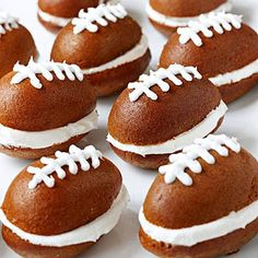 Pumpkin Football Cakes by Better Homes and Gardens. Fluffy pumpkin cakes sandwich creamy vanilla frosting in these festive whoopie pie confections. For the football shape, use a muffin pan with egg-shape wells. Football Party Foods, Football Food, Football Cakes, Football Parties, Football Treats, Football Desserts, Football Tailgate, Football Brownies, Tailgate Parties