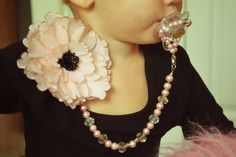 This convertible pacifier clip is made by myself, Kourtney Herring, the clip comes apart to create a necklace, bracelet and hair accessory for the child and mother to wear!