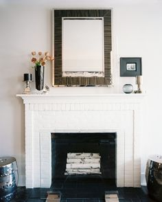 Fireplace Photo - Logs in a white-painted brick fireplace