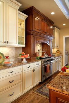 white and brown kitchen features white shaker cabinets paired with