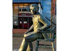 Dylan Thomas statue in front of Mumbles Train Museum ~ Swansea