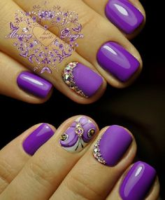 Perfectly purple with this amazing looking summer nail art design. the matte purple background us simply stunning and it is further highlighted by embellishments on top as well as a lone white nail with butterfly details on it.