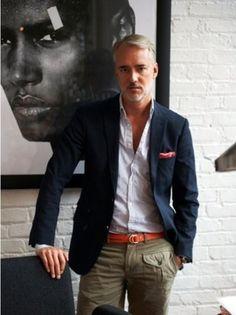 Michael Bastian wearing Navy Blazer, White Long Sleeve Shirt, Khaki Cargo Pants…