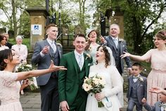 A vintage gown from 'Vintage at number 18' and a made to measure green suit from 'Mayo Clothier' for a Timeless Vintage Inspired Wedding. Photography Rosie Images