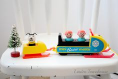 vintage fisher price little people Play family. Never got the snowmobile, just the trailor part.