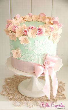 The cake is gorgeous but I also love the color scheme for baby girl's room