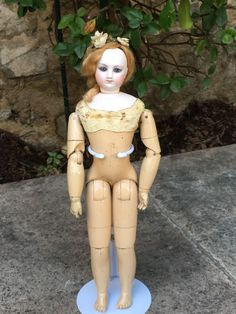 Very wonderful French fashion bisque doll of 15 inches tall with wood body. She is a size 2, head is perfect no cracks no hairlines. She has a nice