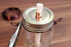Mason Jar Tiki Torches | Fun and Cute Mini Mason Jar Crafts | Creative Home Decor Ideas, Wedding Favors, Makeup Organizers & more! by DIY Ready at http://diyready.com/23-diy-crafts-with-mini-mason-jars/