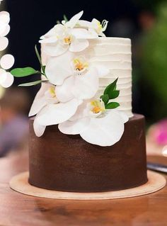 Featured Cake: Butter Bali; Lovely half brown half white orchid topped wedding cake