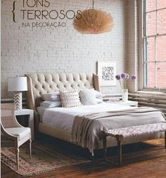 Master Bedroom White Brick Wall As Accent Ivory Tufted Headboard And Rust Coloured Persian Rug Side Tables Brass Glass West Elm