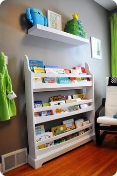 DIY book shelf plans:  http://ana-white.com/2010/04/plans-wall-book-racks-easy-and-inexpensive-organize-your-playroom-today.html