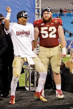 Florida State's Jameis Winston, left, celebrates with Bryan Stork, right. (Bob Leverone/AP)
