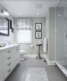 Traditional 3/4 Bathroom with Toto Mercer TL756DDL Widespread Bathroom Faucet, slate tile floors, Flat panel cabinets, Flush
