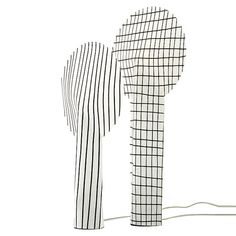 Light from this table lamp is diffused by a lollipop-shaped envelope made from a non-woven fabric.