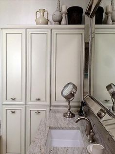 Designer Kerry Fidler transforms a master bath into a one-of-a-kind retreat with beautiful custom cabinetry and luxurious finishes.