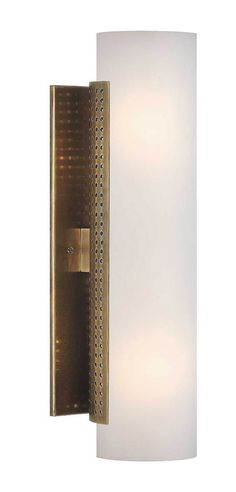 KELLY WEARSTLER   PRECISION CYLINDRICAL SCONCE. Featuring Kelly's signature perforation motif