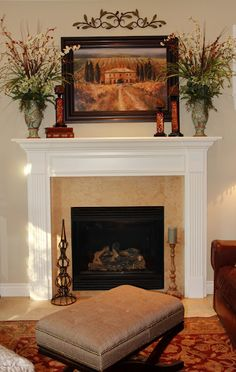 Love the mantle decor: the flowers are perfect.