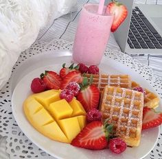 Healthy meal. Strawberry smoothie, mango and waffles