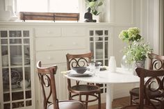 simple style. brown chairs. fresh flowers. {camille styles}