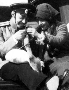 Grand Duchess Anastasia Nikolaevna Romanova of Russia and Taube. >looks like she is trying to show him how to knit. Anastasia Romanov, House Of Romanov, Tsar Nicholas Ii, Lady In Waiting, Imperial Russia, Beautiful Family, Old Photos, Images, Royalty