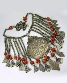 by Moroccan designer Faouzi | Necklace; made from an antique Marrakech headdress piece with silver and coral adornments | 525£
