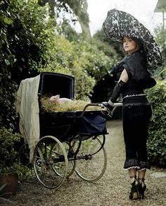 Helena Bonham Carter...modeling her clothing line with a pig in a pram.