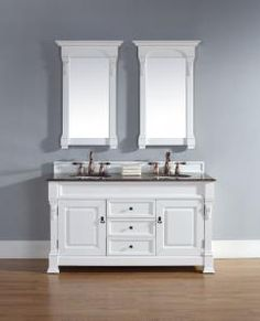 This double sink vanity base has a style with great clean lines that are enhanced by the cottage white finish tone. The carved wood accents add a small elegant touch that is well noticed in this piece. The antiqued brass hardware accents the light finish as well. At five feet in length, this cabinet base has room to include two sinks on the counter top, and there is still plenty of space for use on the counter top. This large size also brings a lot of great storage area with the piece. There…