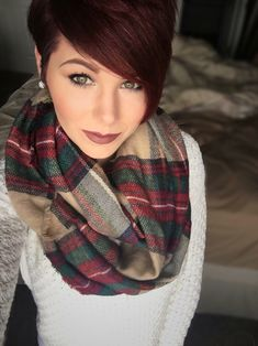 Red pixie cut. I'd have the bangs shorter--not too heavy on top.