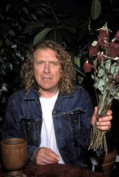 Robert Plant with bouquet of dried up roses
