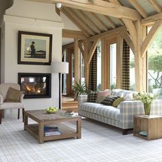 tartan sofa with wood and pale walls