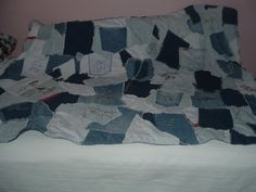 Crazy quilt made of old jeans with embroidery in a western theme