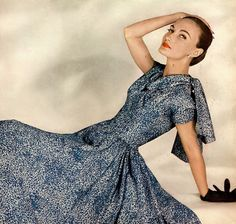 1955 Evelyn Tripp in a mottled sea-blue silk, the fitted bodice has a floating neckline scarf by Pauline Trigere