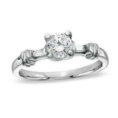 1/2 CT. T.W. Diamond Three Stone Engagement Ring in 14K White Gold