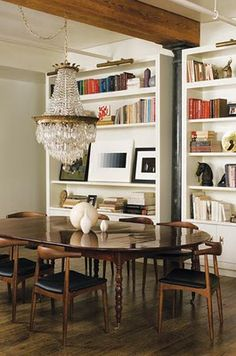 eclectic dining: mid-century chairs, spindle leg table, formal light fixture offers a quirky opportunity to reuse existing chandelier