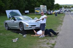 Bill from Race Ramps working on Corvette at Road America.