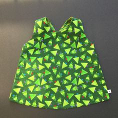 A personal favourite from my Etsy shop https://www.etsy.com/au/listing/259378702/christmas-reversible-pinafore-with-2