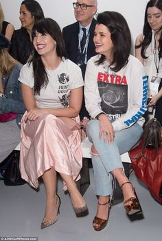 Girls just wanna have fun: The duo appeared to be having a great time together - giggling and chatting animatedly as the models stormed down the catwalk