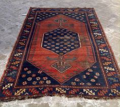 Flora Stunning antique hand knotted rust and blue Persian rug with blue center medallion filled with flowers $585