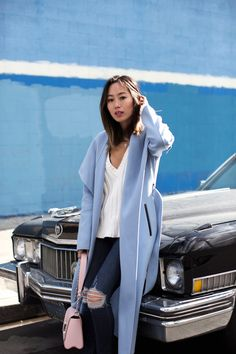 Aimee Song of Style wears a blue wool coat from Mackage