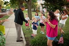 Residents greet President Barack Obama and First Lady Michelle Obama upon their arrival…