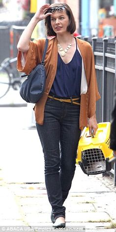 Milla Jovovich stands out in New York as she films scenes for her new movie Cymbeline, August 2013. Nice style: She may have been in character but Milla still looked like her model self in the matching blue and brown attire